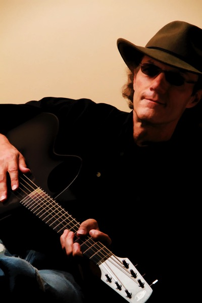 David G. Smith with guitar